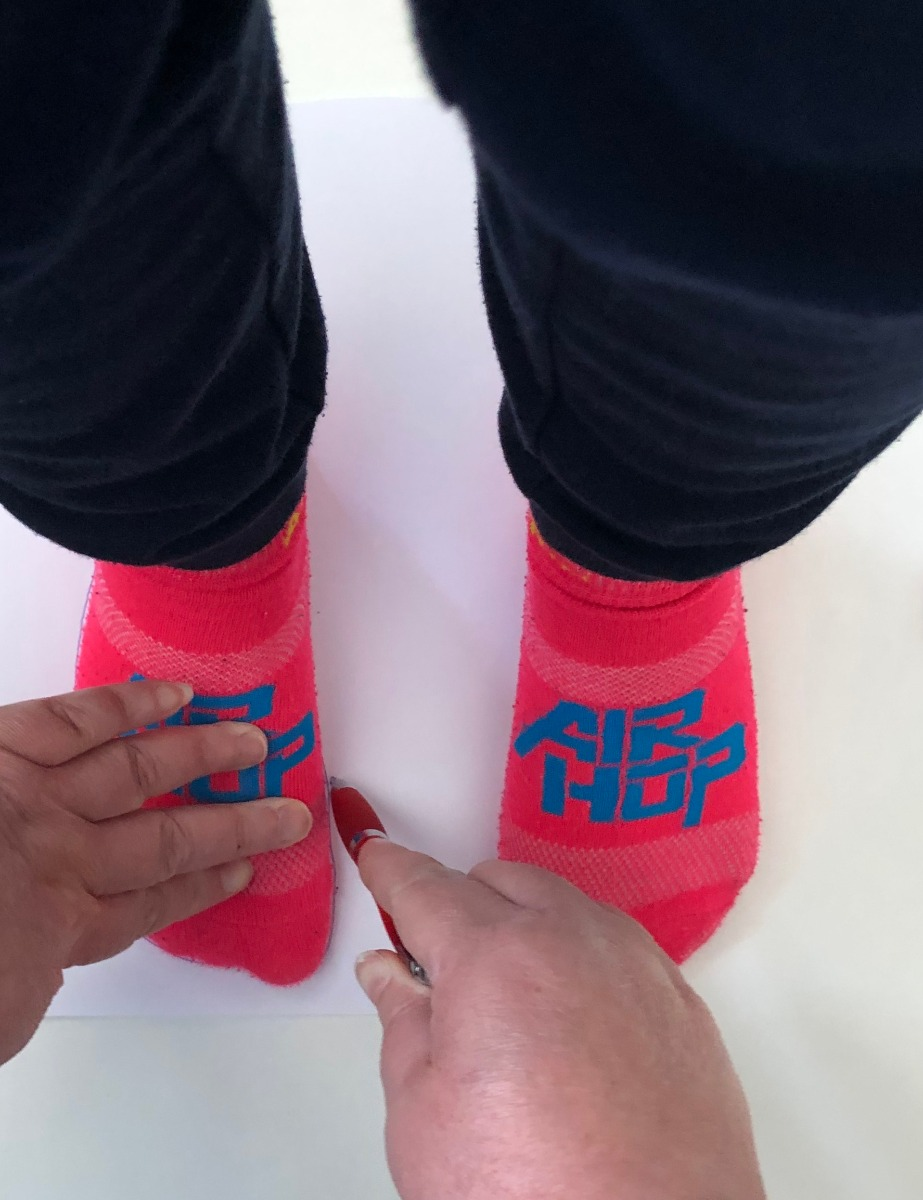 Apply a little pressure to the top of the foot to ensure the toes are completely flat.